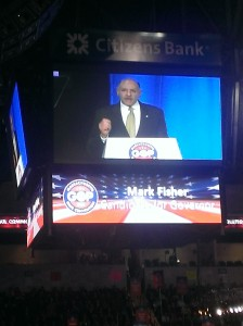 Mark Fisher appearing on the big screen during his speech.