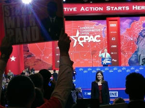 An enthusiastic supporter of straw poll victor Rand Paul holds a sign during his speech to CPAC.