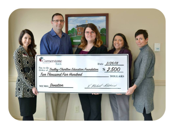 The Dudley Charlton Education Foundation receives a donation from Cornerstone Bank.